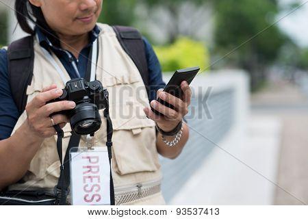 Texting photographer