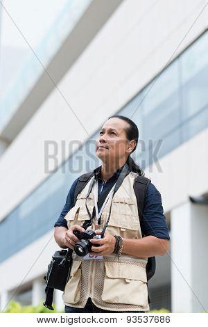 Asian press photographer