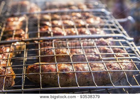 juicy fried meat sausage Grilling outdoors