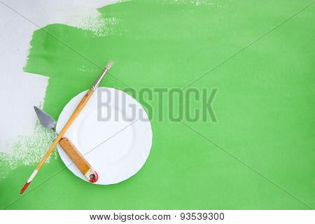 Rough Background With Painting Instruments And A Plate