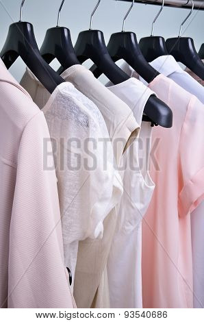 Womens Clothing Pastel Colors Hanging On The Hanger Vertical