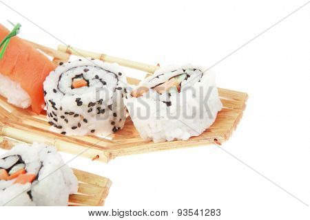 Maki Sushi and Nigiri - Maki Roll made of fresh raw Salmon, Cream Cheese and Avocado inside with Nigiri made of Salmon and Eel. Isolated over white background