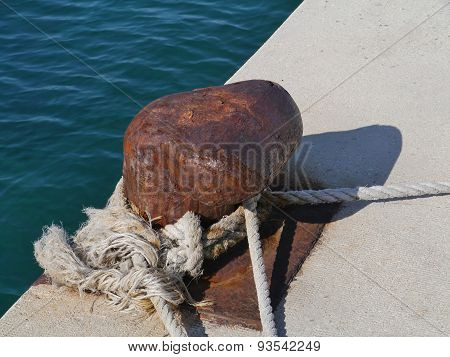 A bollard in the harbor of Biograd