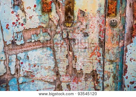 texture of old wooden door with crumbling paint layers