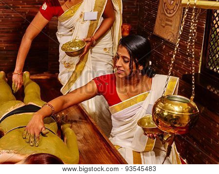 Young woman having body Ayurveda spa massage. Two therapist.
