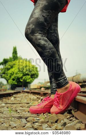 Pink Sneakers On The Railway
