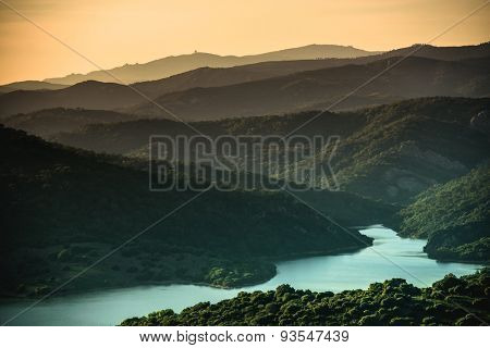 wonderful landscape of sunset in mountain valley with river