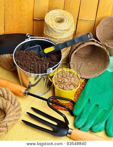 Gardening Tools, Peat Cups, Thread; Seeds In Tins Against Fence