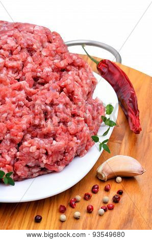Minced Meat With Pepper, Thyme And Garlic On Cutting Board Isolated On White