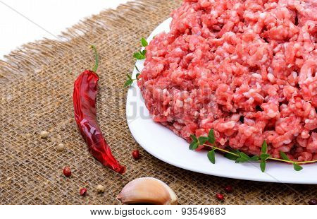 Minced Meat With Pepper, Thyme And Garlic On Sacking Background