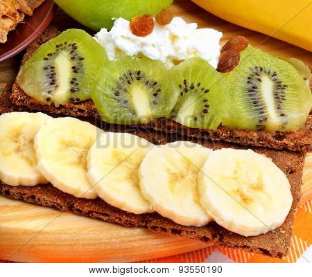 Healthy Eating. Fresh Fruit And Dry Loaves With Curd On A Wooden Background