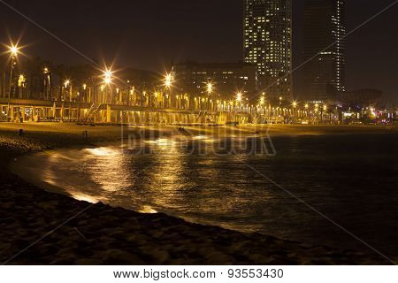 BARCELONA - MAY 1, 2015: View of Somorrostro Beach and towers of Port Olimpic in summer twilight in Barcelona, Spain