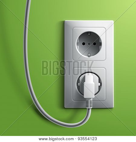 Electric white plug and socket on green wall background