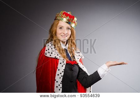 Pretty businessman with crown isolated on gray