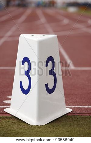 Number Three Signpost In A Athletic Running Track