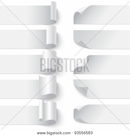 Set of curled blank paper banners with shadows on white backgrou