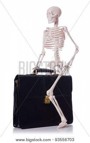 Skeleton with suitcase isolated on white