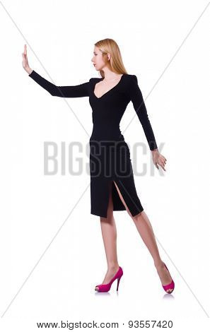 Young girl in black dress pushing isolated on white