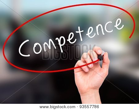 Man Hand writing Competence with black marker on visual screen.