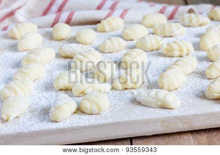 Fresh Homemade Potato Gnocchi On A Wooden Board