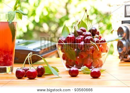 Red Cherry And Glass Of Juice