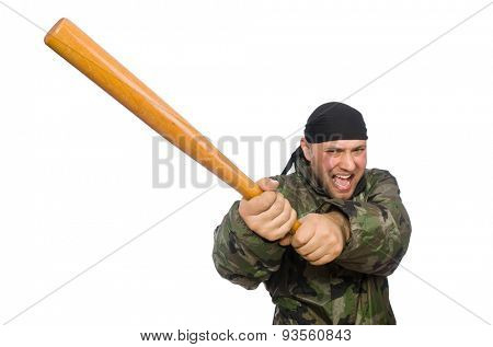 Young man in soldier uniform holding bludgeon isolated on white