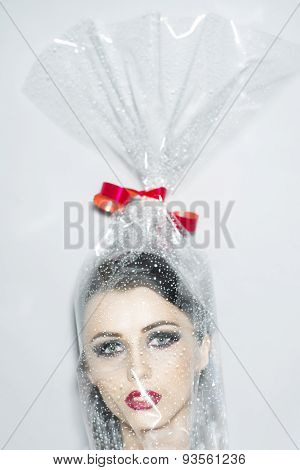 Head Of Beautiful Woman In Cellophane