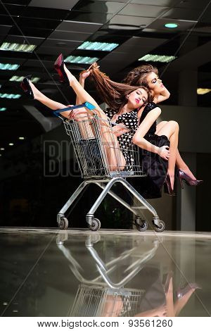 Alluring Girls With Shopping Trolley