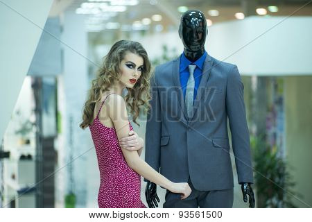 Alluring Girl And Mannequin