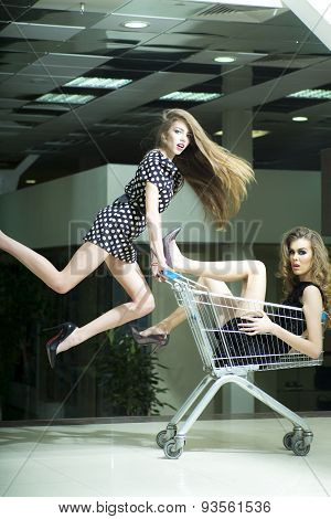 Pretty Girls With Shopping Trolley