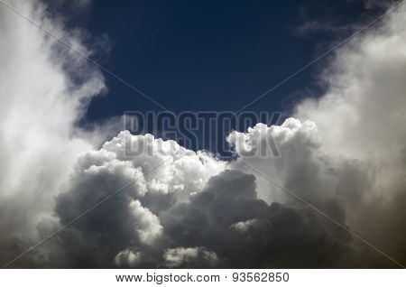Storm clouds against the blue sky