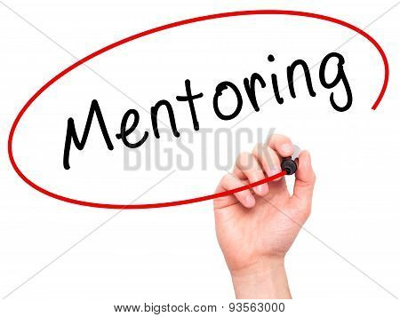 Man Hand writing Mentoring with black marker on visual screen.