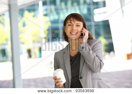 Smiling Business Woman Walking And Talking On Cell Phone