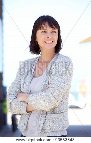 Confident Older Woman Smiling With Arms Crossed