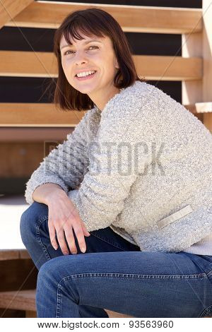 Smiling Older Attractive Woman Sitting Outside