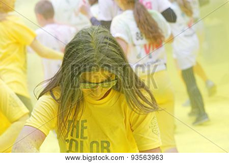 Girl Wearing Sun Glasses Covered With Yellow Color Powder