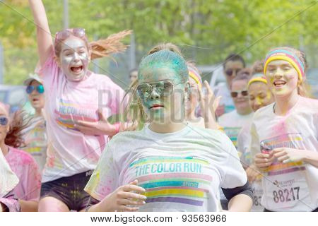Happy Young Girls Covered With Color Powder Running