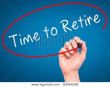 Man Hand writing Time to Retire with black marker on visual screen.