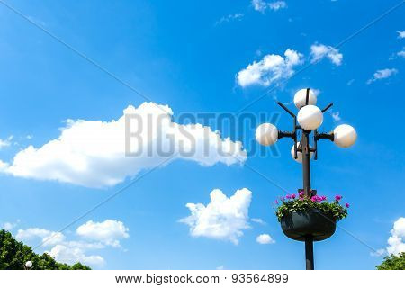 Street Lamps With A Flowers On A Blue Sky Background