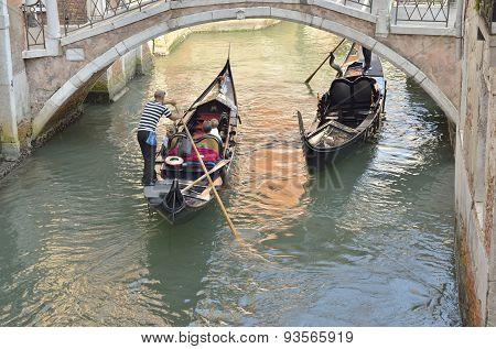 Gondolas Under A Venetian Bridge