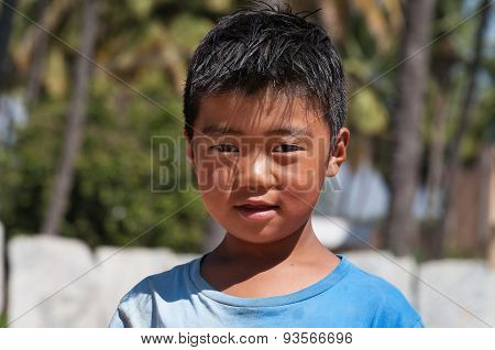 Portrait Of Indian Boy On The Street In Bangalore