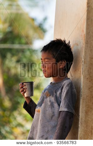 Indian Boy Drinks Water From A Glass On The Street In Bangalore