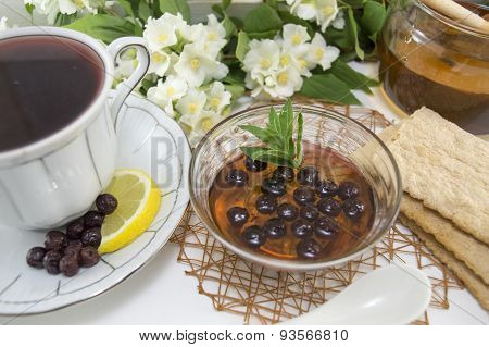 Chokeberry Tea On A Flower Decorated Table