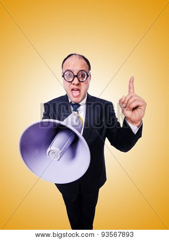Funny man with loudspeaker against the gradient