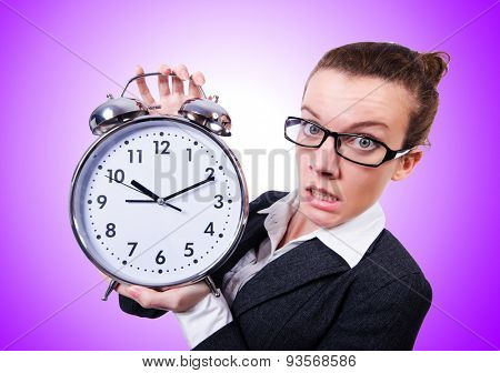Funny woman with clock against the gradient
