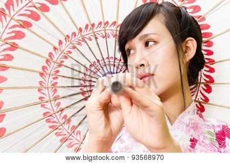 Asian Woman In Kimono Holding Umbrella