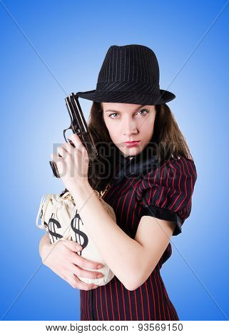 Woman gangster with handgun against the gradient