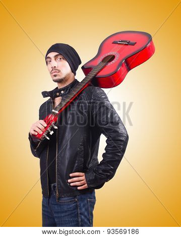 Guitar player against the gradient