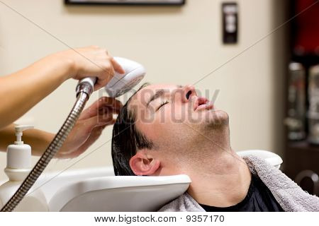 Young Caucasian Man Having His Hair Washed