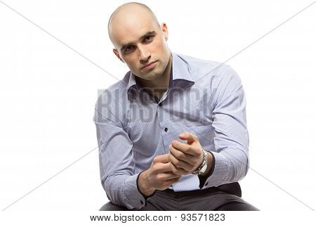 Photo of hairless business man wearing a watch